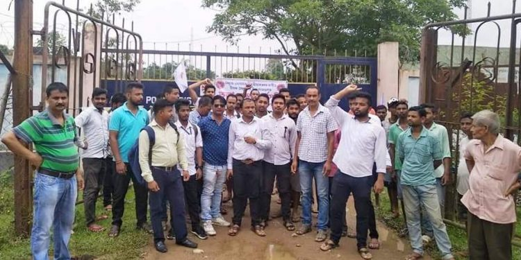 AASU activists stag a dharna in front of the APDCL office in Teok on Tuesday.