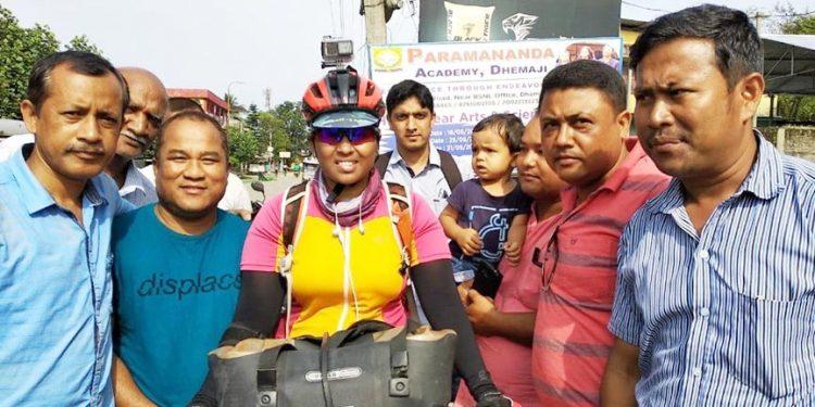 Cyclist  Kumari Jyothi Rongala with local reporters in Dhemaji on Tuesday. Image : Northeast Now