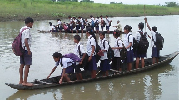 Students crossing river on boat