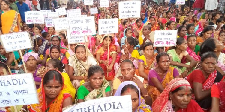 Hundreds of tea garden labourers sit on the roads outside DC office in Silchar chanting slogans and displaying placards demanding for their garden manager's ouster (2)