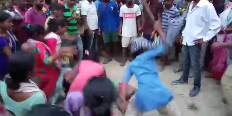 Angry mob brutally thrashed a man and his mother on suspicion of killing the wife of the man.