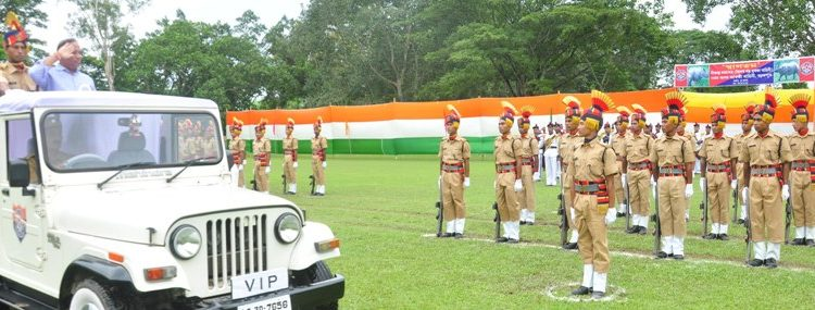 Assam environment and forest minister Parimal Suklabadaiya reviews the passing out parade of SRPF in Nagaon on Friday. Image credit: UB Photos