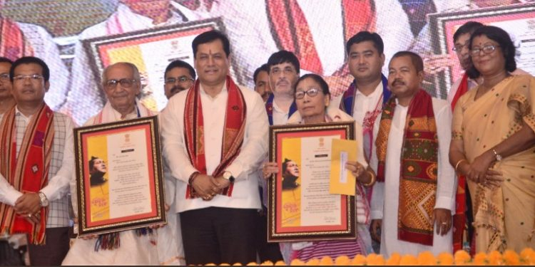 Assam CM Sarbananda Sonowal presents Bishnu Rabha Awards to mask artiste Reba Kanta Mahanta and Manipuri dance exponent Kumari Laitonjam Ebampisok Devi in Goalpara on Thursday.