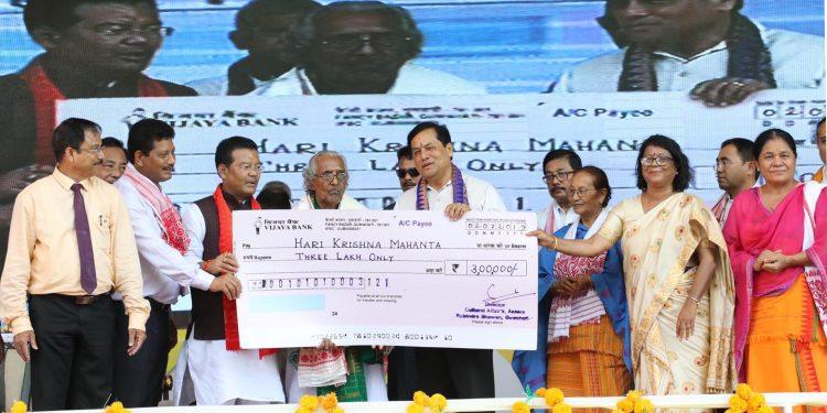 Assam CM Sarbananda Sonowal presenting Kalicharan Brahma award to Satriya exponent Harekrishna Mahanta in Udalguri on Tuesday.