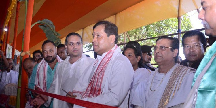 Assam chief minister Sarbananda Sonowal spinning yarn on a spinning wheel as part of an initiative to reproduce the sacred Vrindavani Vastra at the Dakhinpat Satra in Majuli on Sunday.  Image credit - UB Photos