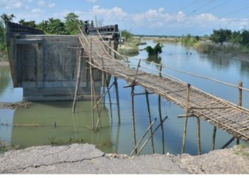 Breach in approach of a bridge with inadequate waterway in Dhemaji district