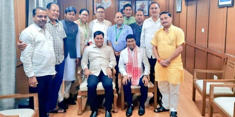 Assam chief minister Sarbananda Sonowal posing for a group photograph with newly-elected MPs from Assam in New Delhi.