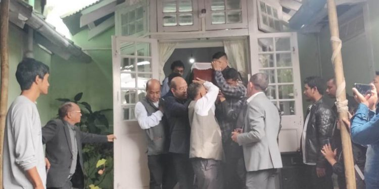 The body of Meghalaya assembly speaker Donkupar Roy being taken out from his official residence in Shillong on Tuesday.