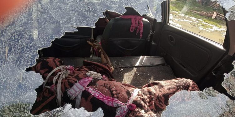 The body of the deceased woman in a vehicle which was damaged by an angry mob. Image credit - Mansh Pratim Gogoi
