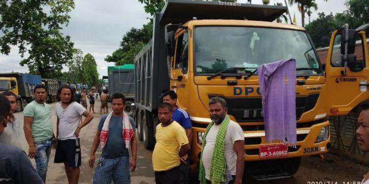 Bhutanese trucks remain stranded at Paikan-Krishnai. Image credit - Northeast Now