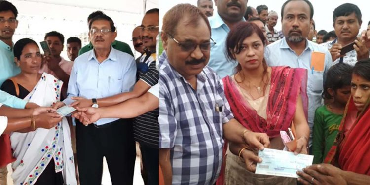 Ex-gratia amount handed over to the next of kin of the two victims who were killed due to floods in Jorhat district. Image credit - Northeast Now