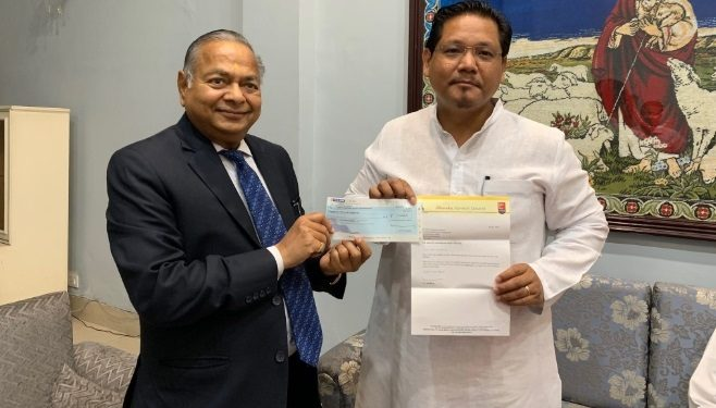 Dhanuka Agritech Ltd official hands over a cheque of Rs 11 lakh to CM Conrad Sangma in Shillong.