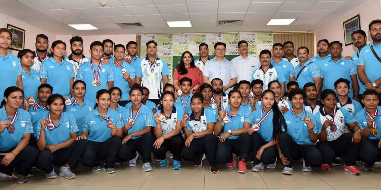 Union sports minister Kiren Rijiju posing for a group photograph with the athletes who won medals for India at Commonwealth Weightlifting Championship in Apia. Image credit - Twitter