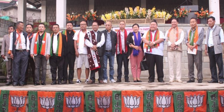 Nagaland BJP leaders with NPF's Arkakong assembly constituency unit members at the event. Image: Northeast Now