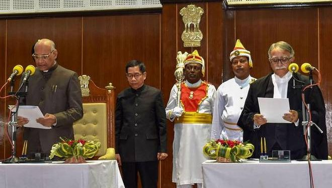 Chief Justice of High Court Justice Sanjoy Koral (R) administers the oath of office to the Tripura Governor Ramesh Bais (L) in Agartala on Monday.