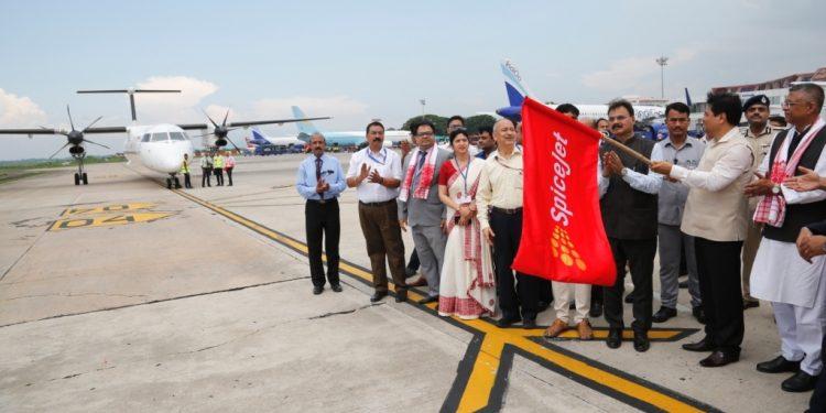 File image of Assam CM Sarbananda Sonowal flagging off the maiden Guwahati-Dhaka flight at LGBI Airport in Guwahati.