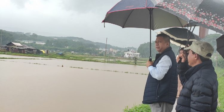 Executive member of the Khasi Hills Autonomous District Council who represents Mawlai constituency Teiborlang Pathaw inspects flood area in Mawlai on July 10, 2019. Image Northeast Now
