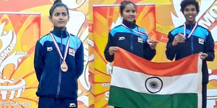 Bornali Borah and Rekhamoni Gogoi after winning medals. Image credit - Twitter sarbanandsonwal
