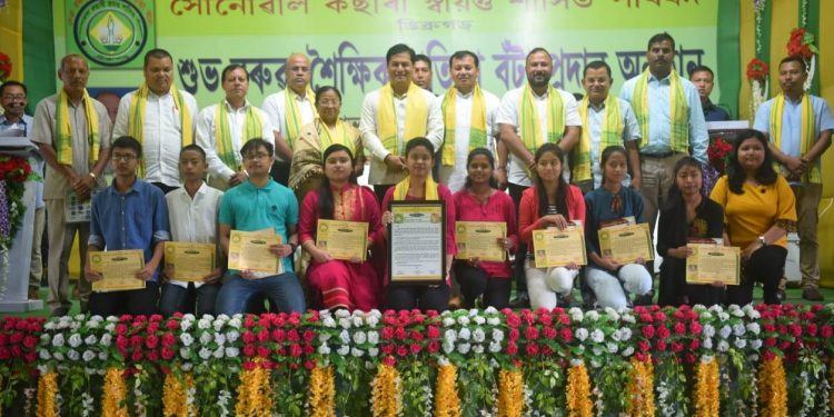 Assam CM Sarbananda Sonowal with the meritorious students at the event in Dibrugarh on Monday.