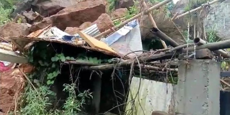 The house which collapsed after a rock fell on it at Katahbari in Garchuk. Image credit - Northeast Now