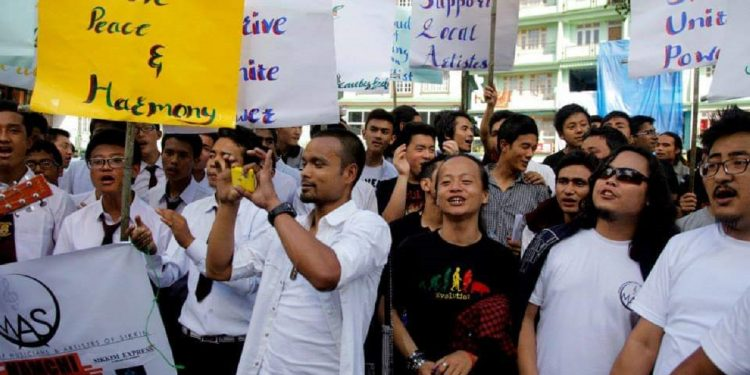 File image of Organization of Musicians and Artistes of Sikkim members taking out a rally in support of their demands. Image courtesy: Facebook