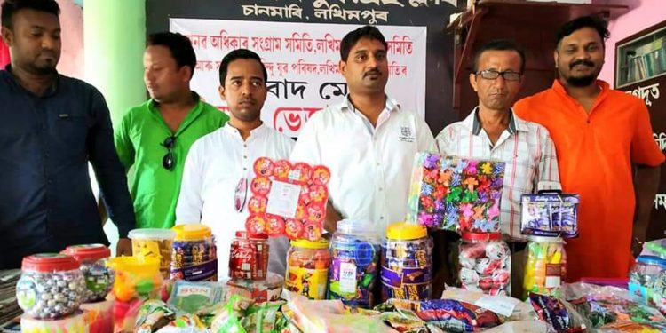 MASS and HYCA leaders with the adulterated candies and confectioneries. Image: Northeast Now