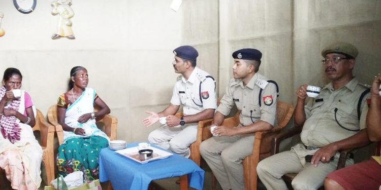 Jorhat SP Vaibhav Nimbalkar (left) and other officials with the witch-hunting victims. Image: Northeast Now