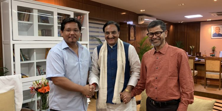 Meghalaya CM Conrad Sangma (left) abd education minister Lahkmen Rymbui (right) with HRD minister Ramesh Pokhriyal Nishank (middle)