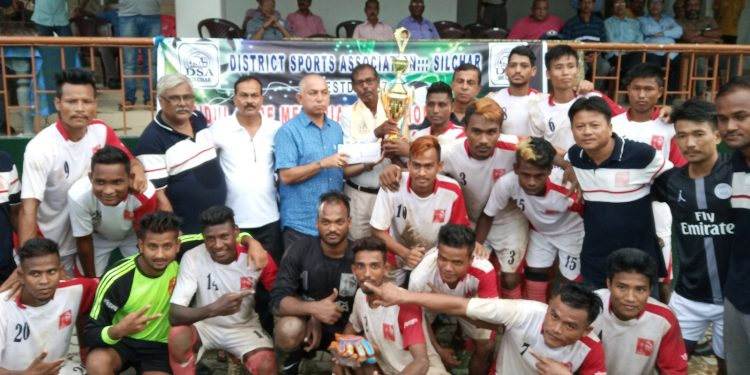 Babul Hore, President, DSA Silchar handing over the Champions trophy to India Club along with a winners cash reward of Rs 10,000 in Silchar on Friday. Image: Northeast Now