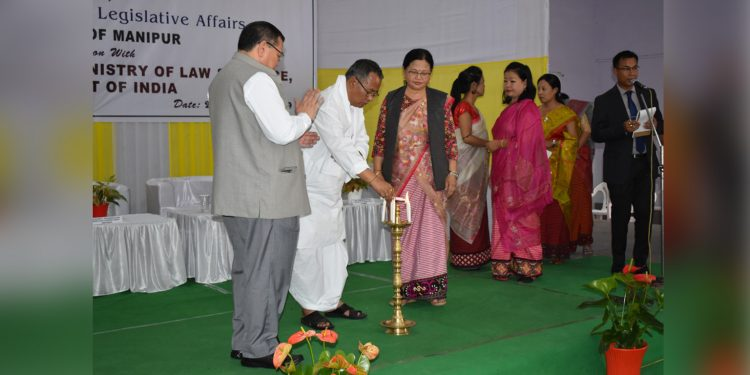 Manipur law minister L Jayentakumar inaugurating the IEC materials on 8 legislations in local dialects releasing function in Imphal on Thursday. Image credit: Suanmoi Guite