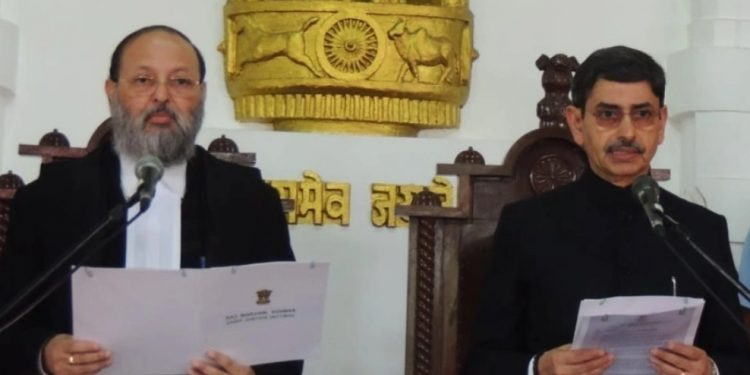 RN Ravi (right) being administered the oath of office as the new governor by Gauhati High Court chief justice (acting) Arup Kumar Goswami.  (File image)