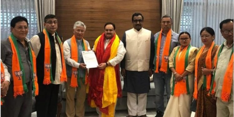 The 10 MLAs of the SDF joined the BJP in presence of party's working president JP Nadda and BJP general secretary Ram Madhav in New Delhi.
