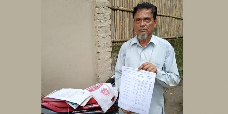 Manik Barbhuiya slowing credentials establishing his Indian identity. Image: Northeast Now
