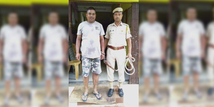 Home guard Sanjay Gohain in police custody. Image: Northeast Now