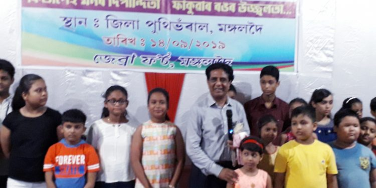 Dr Amarjyoti Choudhury leading a group of children to the library. Image: Northeast Now