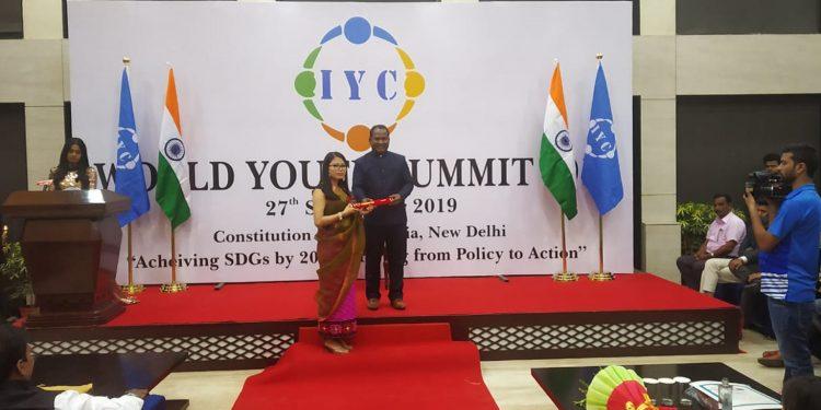 Monika Ingudam while receiving the award in New Delhi