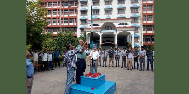 SSA president Ratul Das hoisting the flag on GIMT, GIPS foundation day celebration. Image: Northeast Now