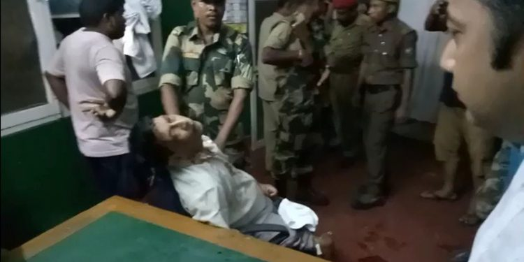 Dr Deven Dutta, who was brutally assaulted by workers of Teok Tea Estate, is being surrounded by security personnel. Image credit - Northeast Now