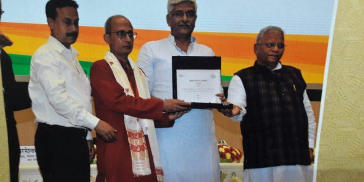 'Doloi' of Kamakhya Temple receiving the award. Image: Northeast Now