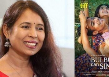 Rima Das and poster of Bulbul Can Simgh