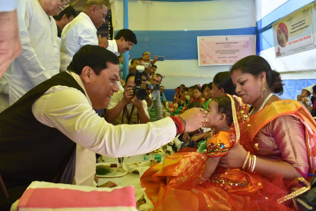 Sonowal feeds baby