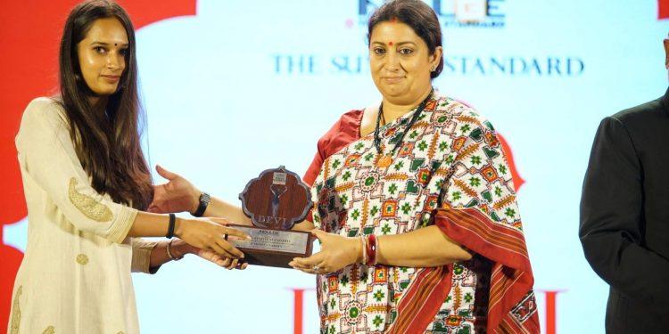 Educator and social entrepreneur Parmita Sarma receiving her award from union minister Smriti Irani at Kolkata