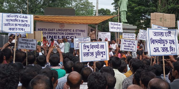 The activists of NELECC staging a protest in Silchar on Tuesday.