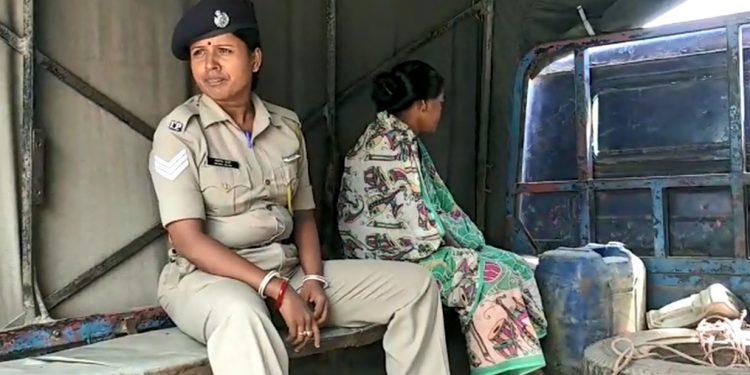 Arrested Jhulan Biswas being taken to East Agartala police station.