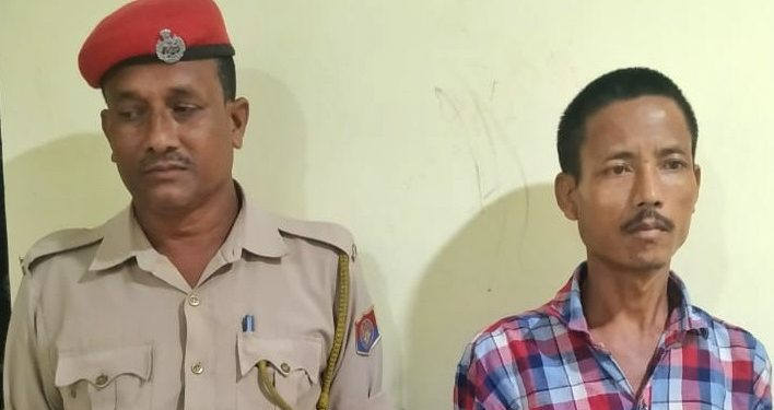 The accused father Birbal Boro(right) at Kaurbaha outpost in Baksa district of Assam. Image: Northeast Now