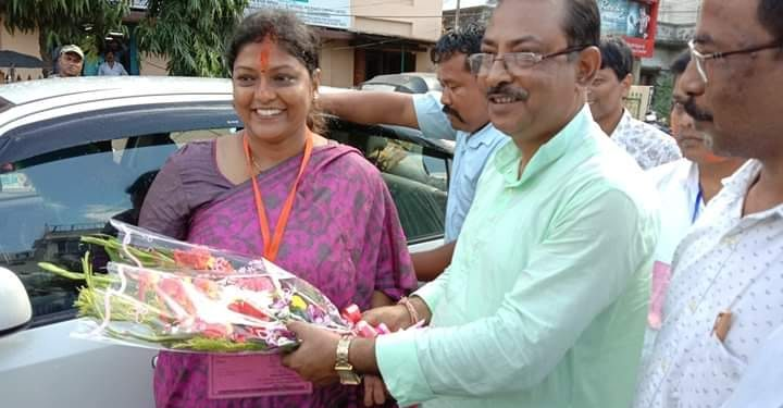 BJP nominee Mini Majumder being greeted by party workers after poll victory.