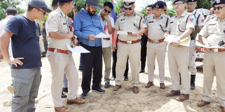 Nagaland deputy chief minister, Y Patton with police officials at the site of the September 6 violent incident along the Dimapur-Peren boundary. Handout image