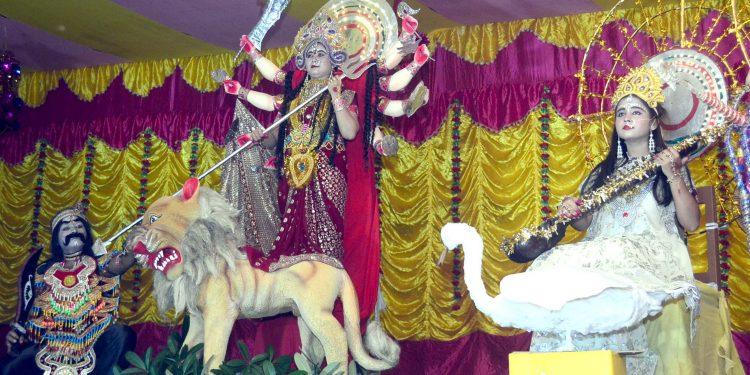Brahmakumari Eshwari Vishwavidyalaya volunteers enact live Durga and other deities at Demow in Sivasagar on Saturday. Image by UB Photos