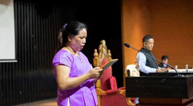 Arunachal assembly speaker Pasang Sona administers the oath to newly elected Khonsa West MLA Chakat Aboh.