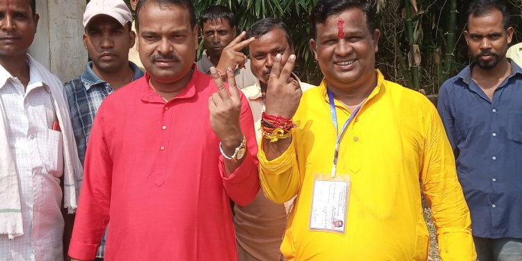 Karimganj MP Kripanath Mallah along with BJP candidate BIjay Malakar after casting his vote on Monday.